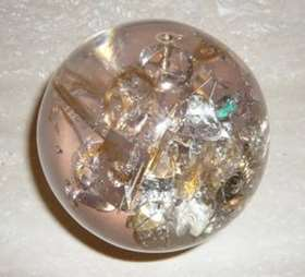 Resin sphere with inclusion of watches component