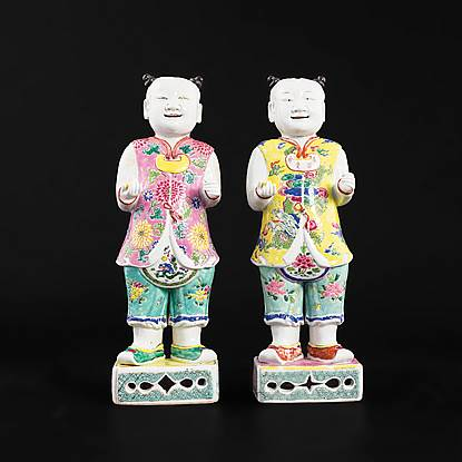 pair of chinese export porcelain famille rose figures of standing boys