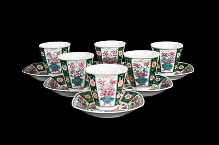 set of six Chinese porcelain famille rose black ground beakers and saucers