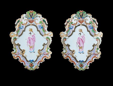 Pair of Chinese export porcelain wall sconces with the torchbearer design attributed to Cornelis Pronk