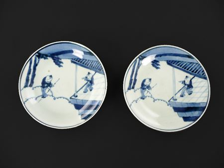 pair of blue and white arita porcelain saucers