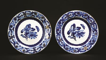 a pair of chinese export porcelain blue and white dinner plates with designs after maria sybille merian