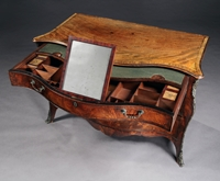 A George III period mahogany serpentine commode Attributed to Henry Hill of Marlborough