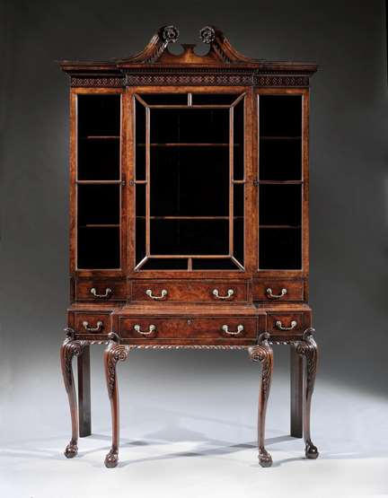 A rare George II Period walnut and burr walnut veneered breakfront cabinet on stand in the manner of Giles Grendey