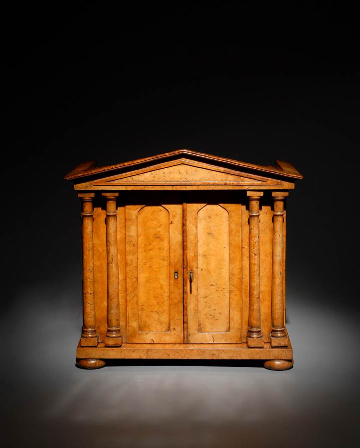A fine burr elm collectors cabinet of architectural form