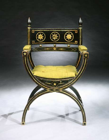 An Impressive Ebonised and Gilt Decorated Regency Period X-Framed Armchair