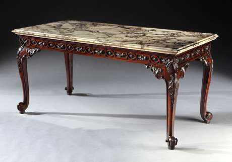 An exceptional George II period carved mahogany serving table with Breccia Rosato marble top