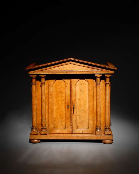 A fine burr elm collectors cabinet of architectural form