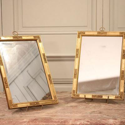 Paire de miroirs à suspendre en bronze doré