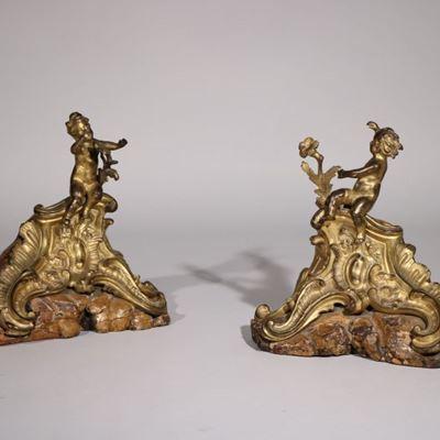 Paire de chenets en bronze doré et ciselé