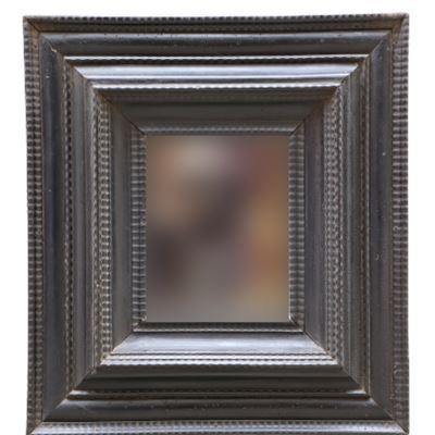 Miroir en bois noirci mouluré