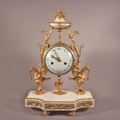 Pendule aux phoenix en marbre de Carrare et bronze doré