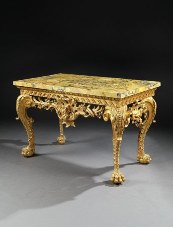 A GEORGE II GILTWOOD SIDE TABLE IN THE MANNER OF MATTHIAS LOCK