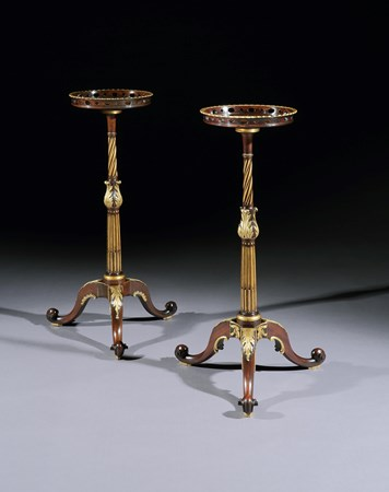 A NEAR PAIR OF GEORGE II PARCEL GILT MAHOGANY TORCHÈRES