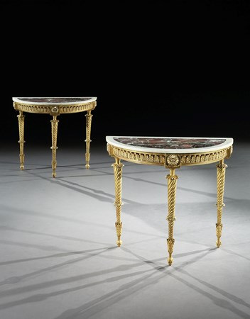 A PAIR OF GEORGE III DEMI-LUNE GILTWOOD SIDE TABLES