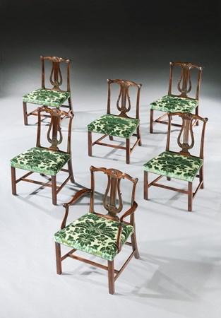 A SET OF TWELVE GEORGE III MAHOGANY DINING CHAIRS TO A DESIGN BY ROBERT ADAM AND ATTRIBUTED TO THOMAS CHIPPENDALE