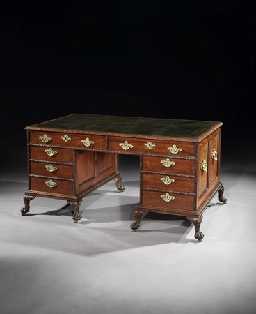 A GEORGE II MAHOGANY PEDESTAL WRITING DESK ATTRIBUTED TO WILLIAM HALLETT
