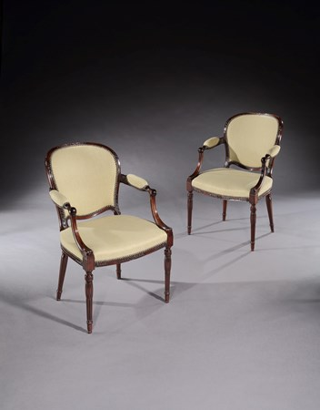 A PAIR OF GEORGE III MAHOGANY ARMCHAIRS ATTRIBUTED TO JOHN LINNELL