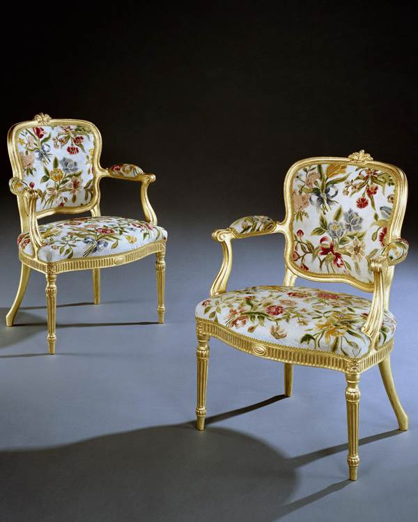 A PAIR OF GEORGE III GILTWOOD ARMCHAIRS ATTRIBUTED TO THOMAS CHIPPENDALE