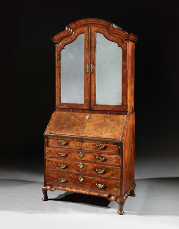 A GEORGE I WALNUT BUREAU CABINET ON CABRIOLE LEGS
