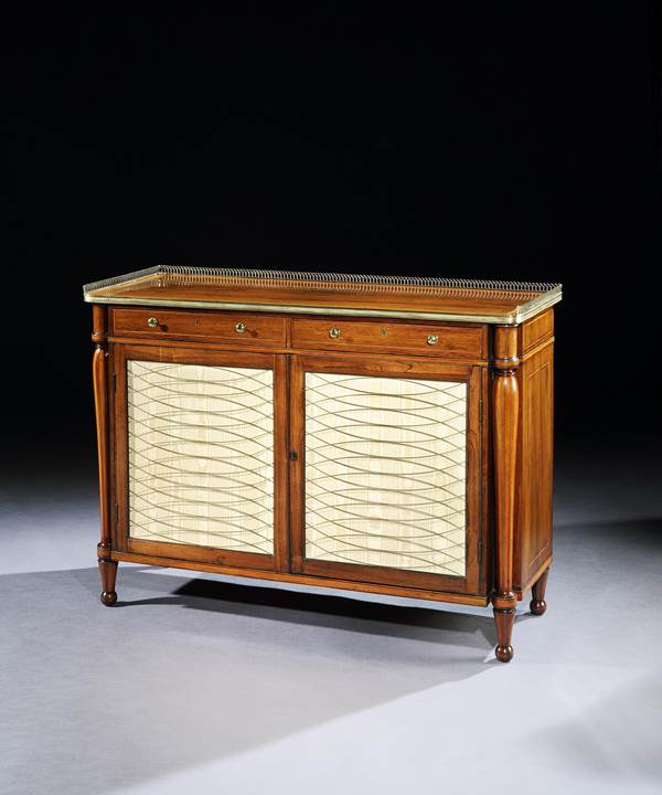 A PAIR OF GEORGE III BRASS MOUNTED ROSEWOOD SIDE CABINETS