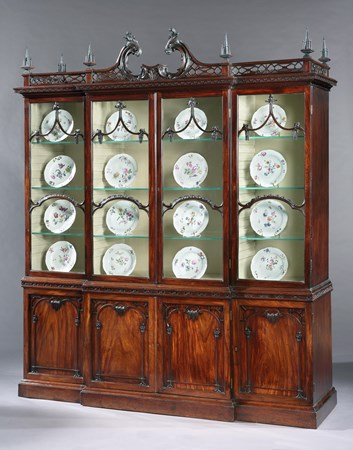 AN IMPORTANT GEORGE II MAHOGANY CHINA CABINET TO A DESIGN BY THOMAS CHIPPENDALE