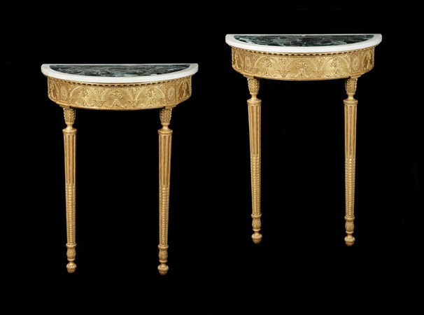 A PAIR OF GEORGE III DEMI-LUNE GILTWOOD CONSOLE TABLES ATTRIBUTED TO ROBERT ADAM
