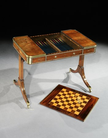 A REGENCY BRASS MOUNTED ROSEWOOD GAMES TABLE