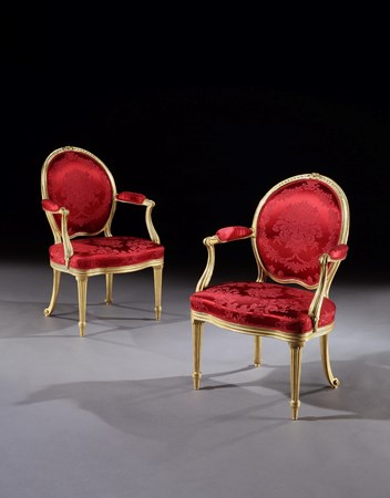 A PAIR OF GEORGE III GILTWOOD OPEN ARMCHAIRS ATTRIBUTED TO THOMAS CHIPPENDALE