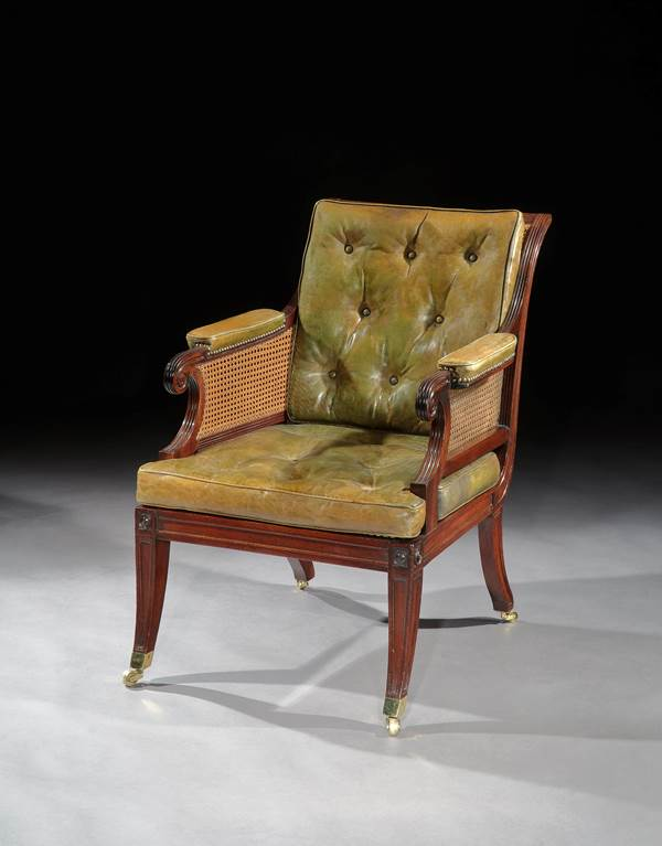 A PAIR OF REGENCY MAHOGANY BERGERE CHAIRS