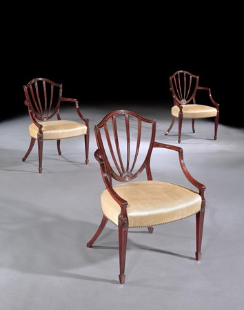 A SET OF SIX GEORGE III MAHOGANY OPEN ARMCHAIRS ATTRIBUTED TO GILLOWS