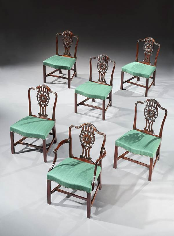 A SET OF FOURTEEN GEORGE III MAHOGANY DINING CHAIRS