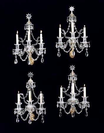 A SET OF FOUR GEORGE III ORMOLU MOUNTED CUT GLASS WALL LIGHTS ATTRIBUTED TO WILLIAM PARKER
