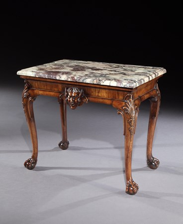 A GEORGE II WALNUT SIDE TABLE ATTRIBUTED TO GILES GRENDEY