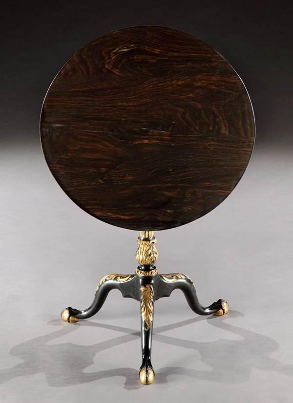 A RARE COLONIAL GEORGE II PARCEL GILT EBONY TRIPOD TABLE