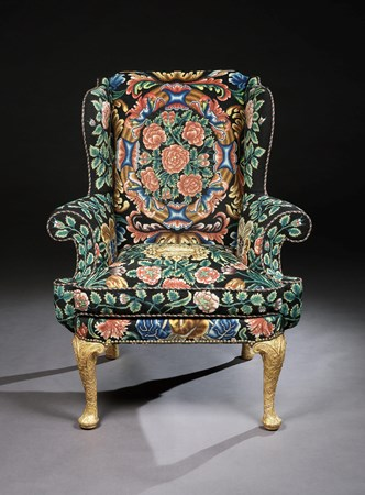 A GEORGE I GESSO AND NEEDLEWORK WING CHAIR