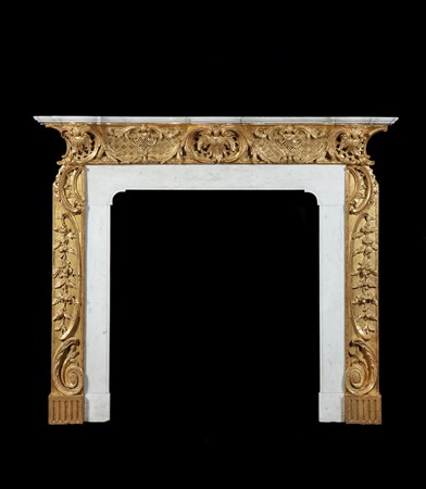 A GEORGE II GILTWOOD AND STATUARY MARBLE CHIMNEYPIECE TO A DESIGN BY THOMAS JOHNSON
