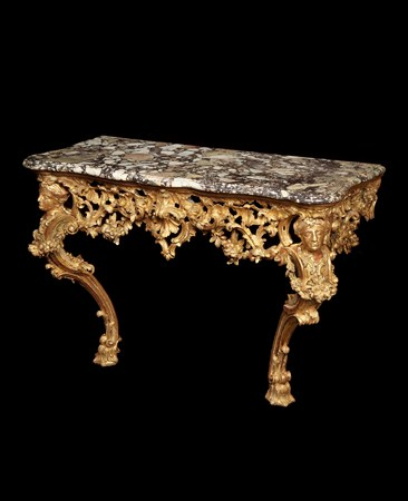 A GEORGE II GILTWOOD CONSOLE TABLE ATTRIBUTED TO MATTHIAS LOCK