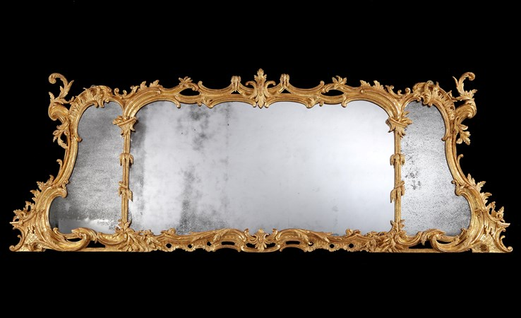 A GEORGE II GILTWOOD OVERMANTEL MIRROR