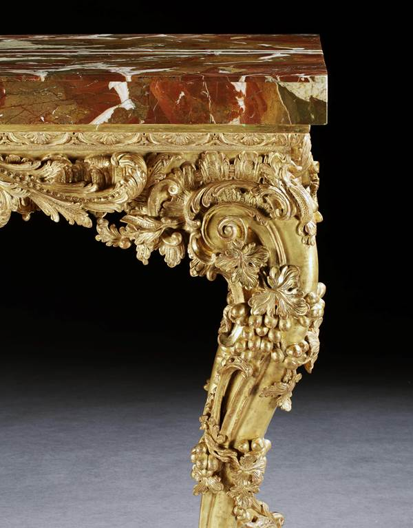 A GEORGE II GILTWOOD SIDE TABLE ATTRIBUTED TO MATTHIAS LOCK