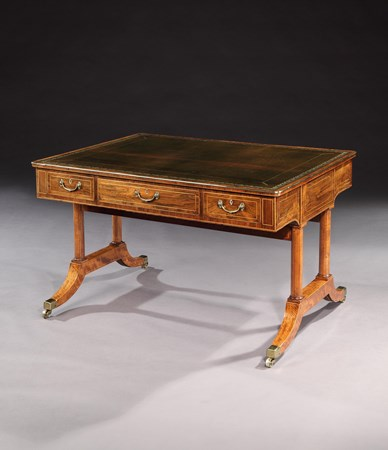 A GEORGE III BRASS MOUNTED ROSEWOOD WRITING TABLE