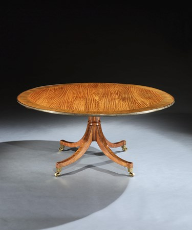 A GEORGE III BRASS MOUNTED SATINWOOD CIRCULAR BREAKFAST TABLE