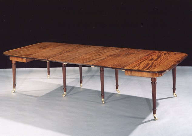 A GEORGE III MAHOGANY 'IMPERIAL DINING TABLE' ATTRIBUTED TO GILLOWS