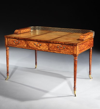 A GEORGE III SATINWOOD WRITING TABLE BY JAMES BAILLIE