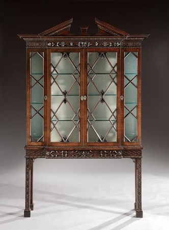 A GEORGE II MAHOGANY BOOKCASE ON STAND TO A DESIGN BY THOMAS CHIPPENDALE