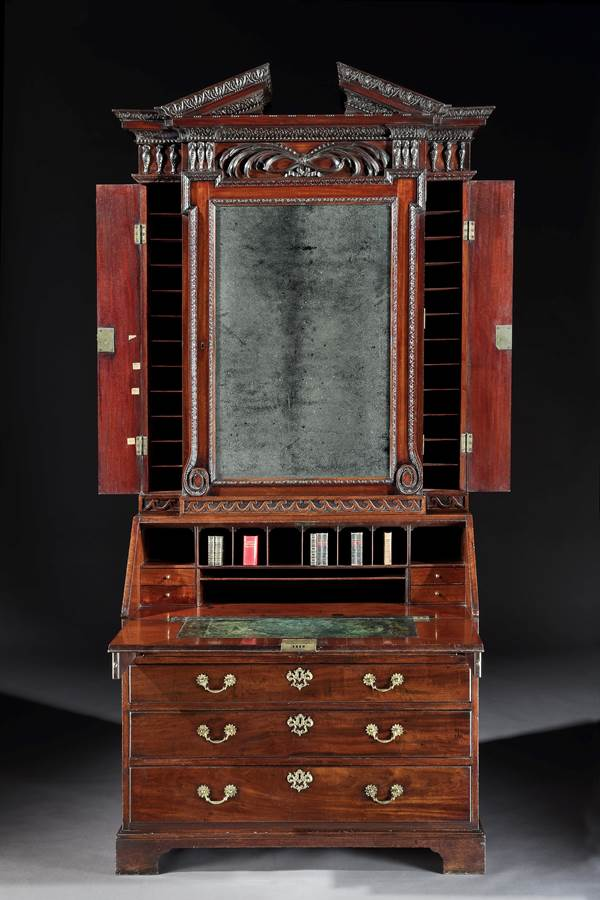A GEORGE II MAHOGANY BUREAU CABINET DESIGNED BY WILLIAM KENT AND ATTRIBUTED TO WILLIAM HALLETT