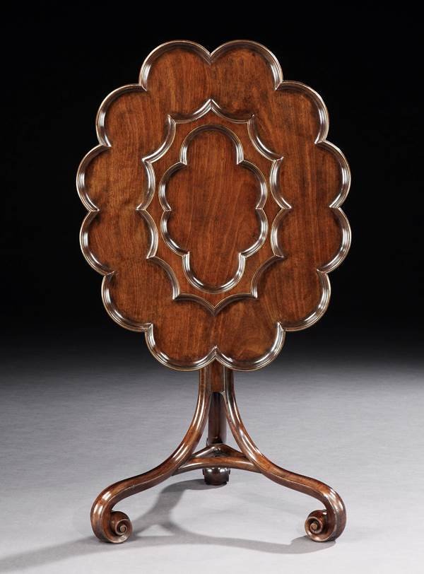 AN EXCEPTIONALLY RARE GEORGE II MAHOGANY OVAL TRIPOD TABLE