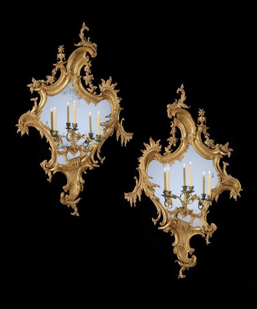 A HUGE PAIR OF GEORGE II CARVED GILTWOOD GIRANDOLES TO A DESIGN BY THOMAS CHIPPENDALE