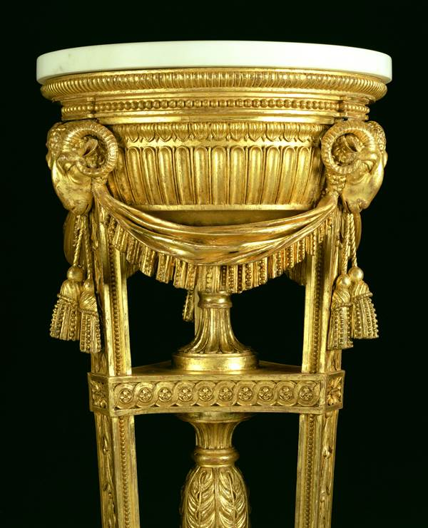 AN ADAM PERIOD CARVED GILTWOOD TORCHÉRE