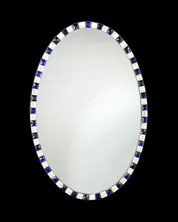 AN IRISH GEORGE III OVAL MIRROR